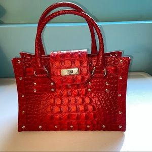 Le Solim red leather crocodile embossed purse